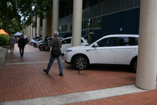 Cars including Mitsubishi Outlander PHEV SUV, which does 50 km on a charge, before switching over to its petrol engine.