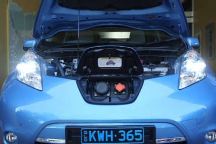 Nissan Leaf with charging port and bonnet open.