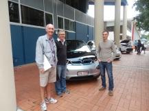 Three happy EV owners.