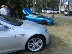 Tesla Model S in foreground, with Tesla Roadster in background